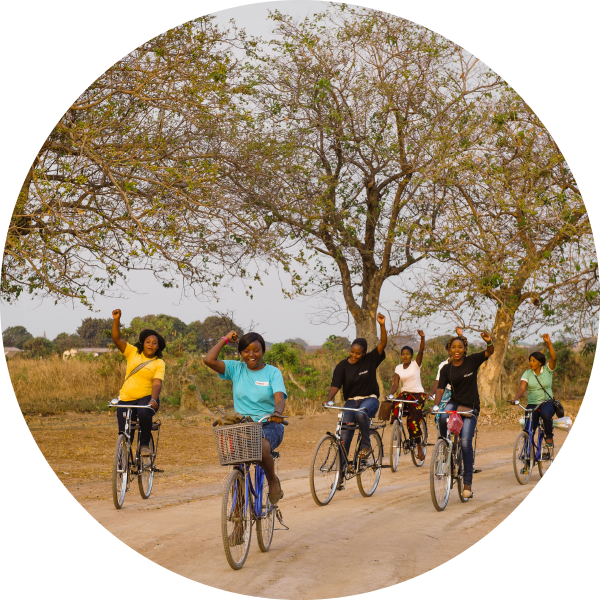 CAMFED leaders riding bicycles