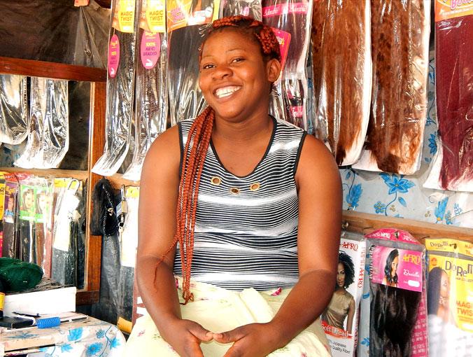 CAMA entrepreneur Sandra in her beauty supplies shop.